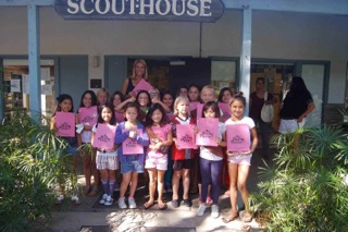 Brownie Troop Learns how to save, spend and share